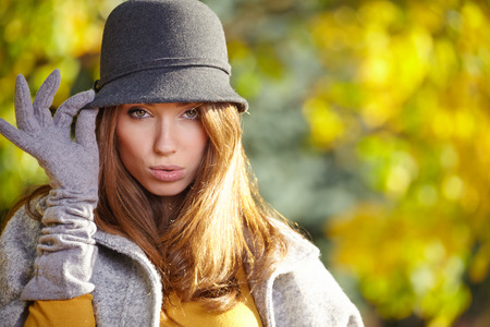 Fashion woman walking in autumn park  photo