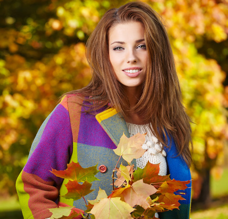 Beautiful elegant woman  in a park in autumn photo