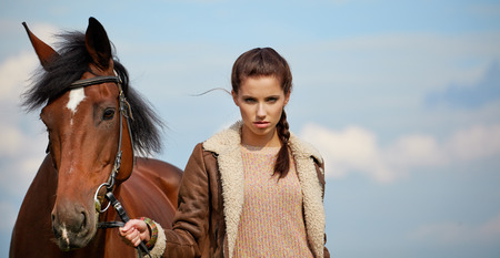 Girl and horse on the walk  photo