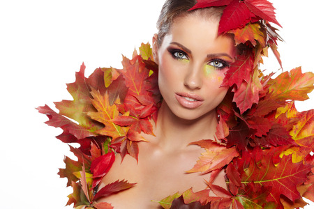 Autumn woman dressed in red leaves photo