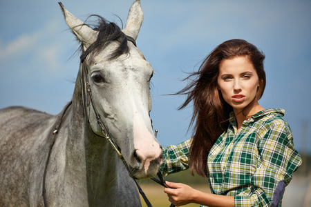 Woman with a white horse  photo