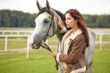 woman long hair kissing beautiful horse  photo