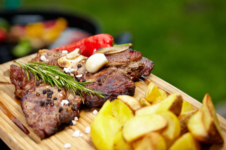 tbone: Grilled T-bone steak seasoned with spices and fresh herbs