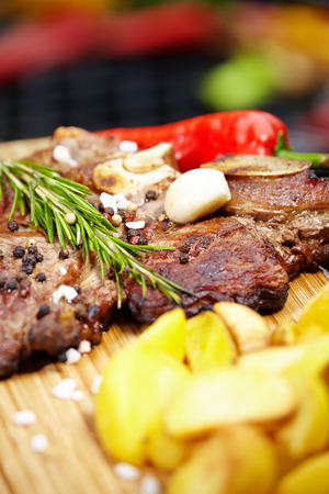 homemade style: Grilled T-bone steak seasoned with spices and fresh herbs