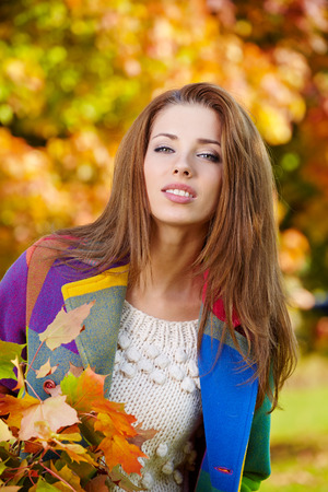 light brown eyes: Beautiful woman in autumn park