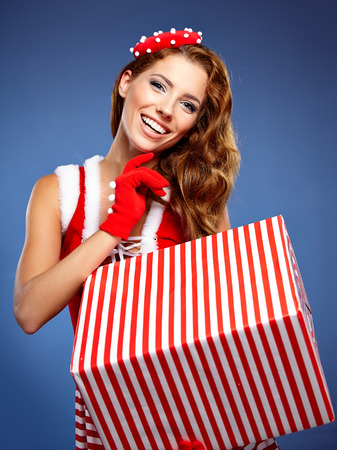 Beautiful  woman in Santa Claus clothes with gift photo