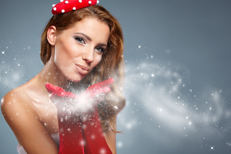 ttractive: Beautiful  woman in Santa Claus clothes with gift