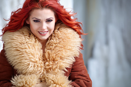 red hair woman: Attractive red hair woman in wintertime outdoor