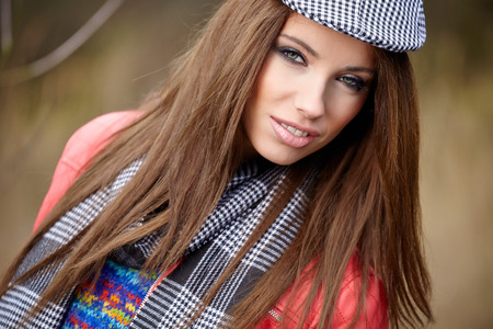 Beautiful fashion woman in a park in autumn  photo