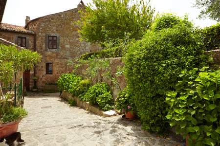 Old small stone medieval street in historical town, Italy photo