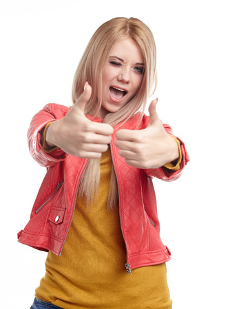 Smiling woman with thumbs up photo