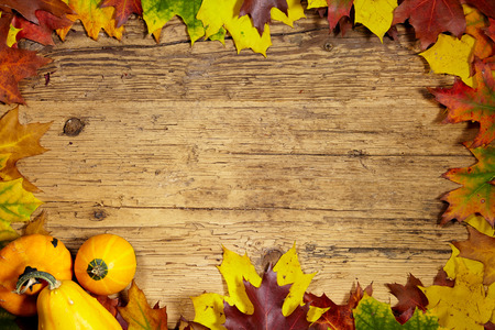 red background: Thanksgiving Autumn Fall background with red, brown and yellow leaves and pumpkin