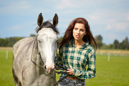 caresses: portrait beautiful woman long hair next horse