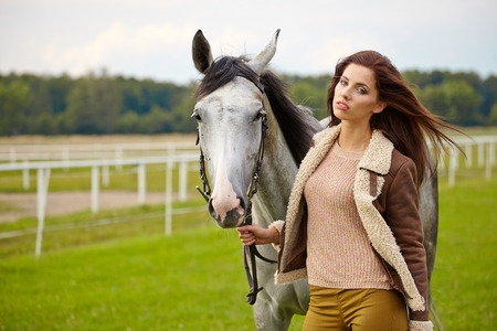 portrait beautiful woman long hair next horse photo