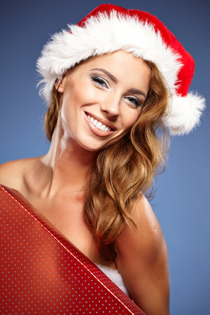 christmas woman with gifts box photo