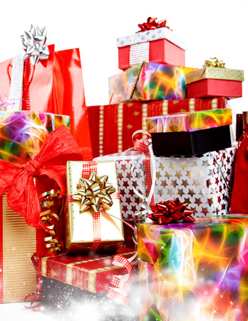 christmas wrapping: A pile of Christmas gifts in colorful wrapping with ribbons.