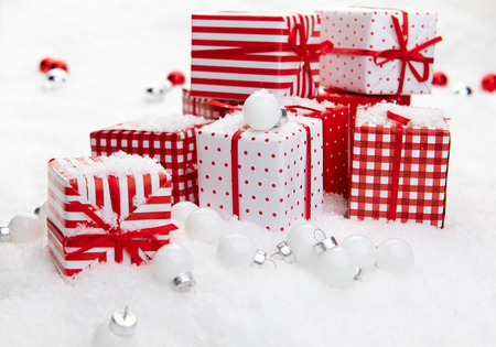 Small Handmade gift boxes in snow photo