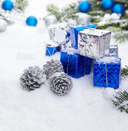 scene season: Blue chrismas  gifts box on snow