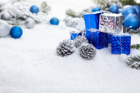 wintry: Blue chrismas  gifts box on snow