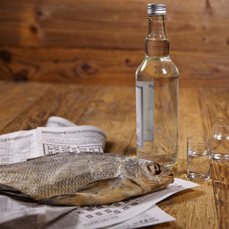 vodka bottle: Russian snack . Vodka and dried fish