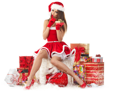 red gloves: Sexy girl wearing santa claus clothes with gifts Stock Photo