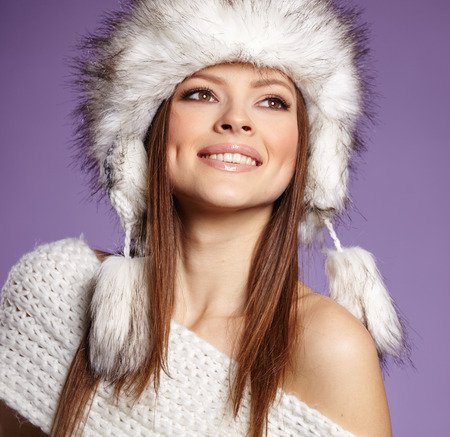 Fur Fashion. Beautiful Girl in Fur Hat. Winter Woman Portrait photo