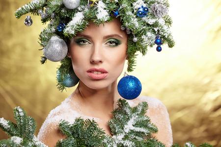 Beautiful woman portrait in creative christmas image. photo