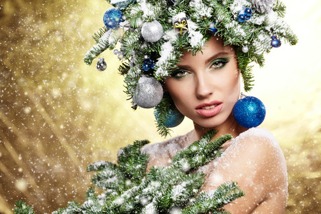 Young woman in creative image with green artistic make-up. photo