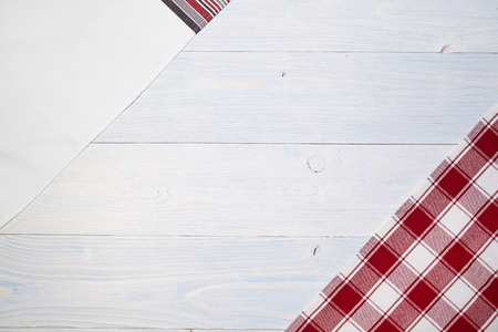 red folded tablecloth over old wooden table photo