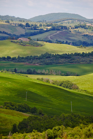 orcia: Scenic Tuscany landscape with rolling hills and beautiful cloudscape in Val dOrcia, Italy
