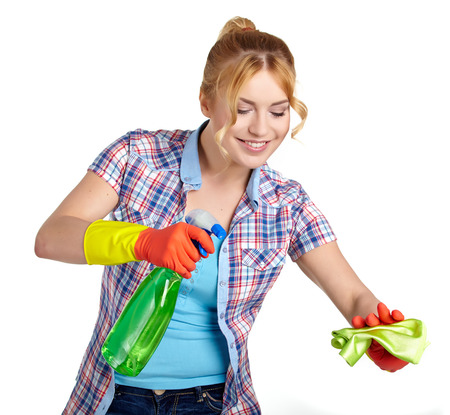 young housewife cleaning on white photo
