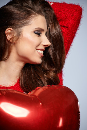 Beautiful woman  holding red balloon. Valentines day comcept. photo