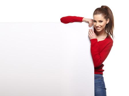 billboard blank: Beautiful young woman with white blank  board Stock Photo