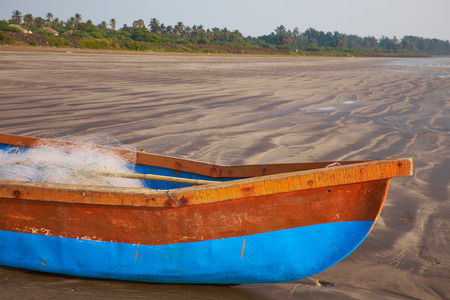 Old beached fishing Boat - Asian Style photo