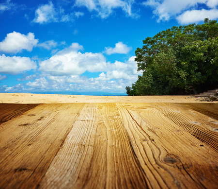empty room background: Old wooden table with sea scene in background Stock Photo