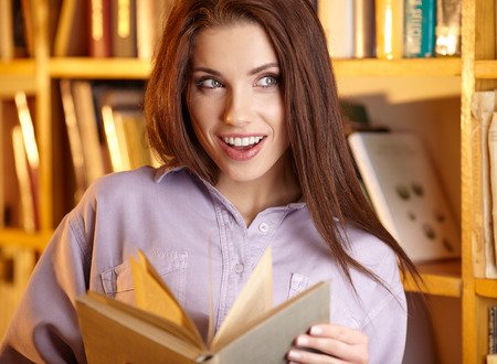 library student: Beautiful female student in a university library Stock Photo