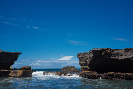 wide wet: Tropical beach with volcanic rocks, Bali, Indonesia