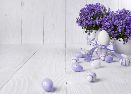 Easter holiday eggs decoration on wooden table photo
