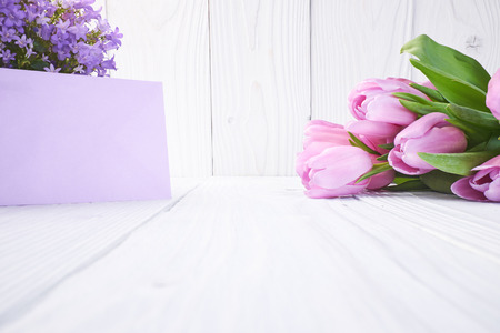 tulips and post card. March 8th, mothers day, valentines day, International Womens Day, lilac, congratulate, celebrate