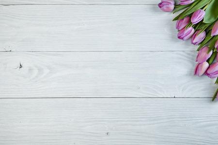 Purple tulips  on old used wood photo