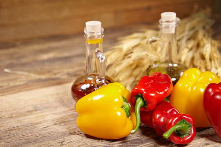 sweet peppers, wooden table background photo