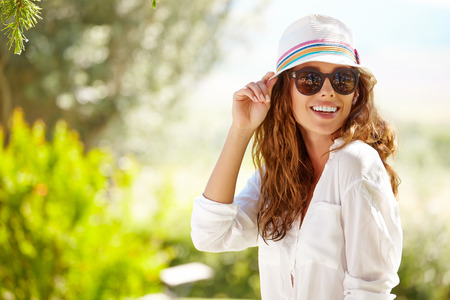 woman beauty: Smiling summer woman with hat and sunglasses Stock Photo
