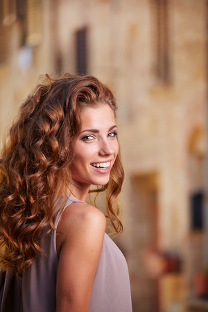 Beautiful woman on the streets of the old Italian town photo