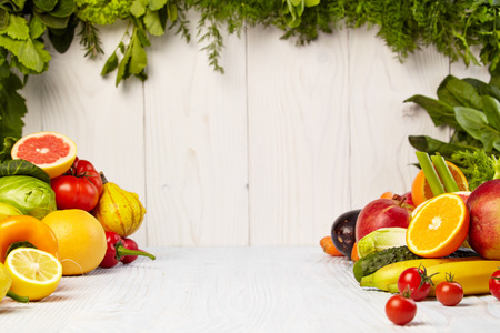 fruit red: Fruit and vegetable borders Fruit and vegetable borders on wood table