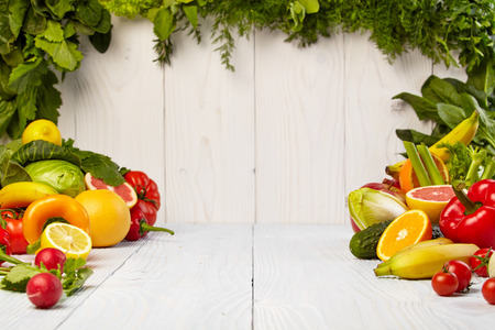 of fruit: Fruit and vegetable borders Fruit and vegetable borders on wood table