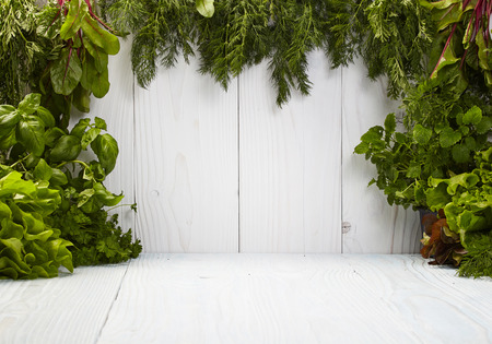 Green frame on white boards made from herbs photo