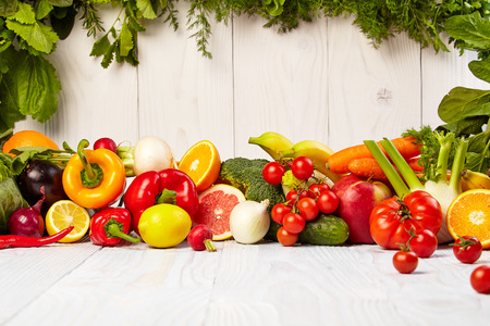 Fruit and vegetable borders Fruit and vegetable borders on wood table photo