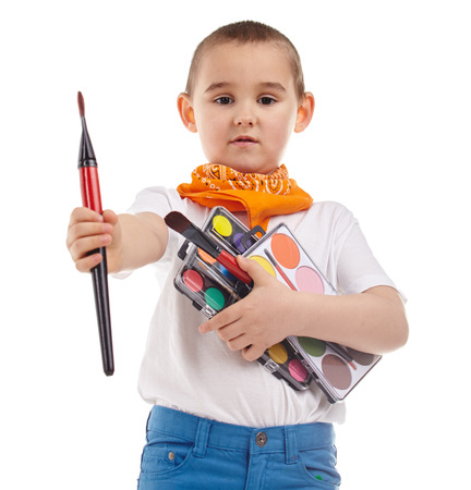 Portrait of a little boy enjoying his painting. Education. Isolated over white background. photo