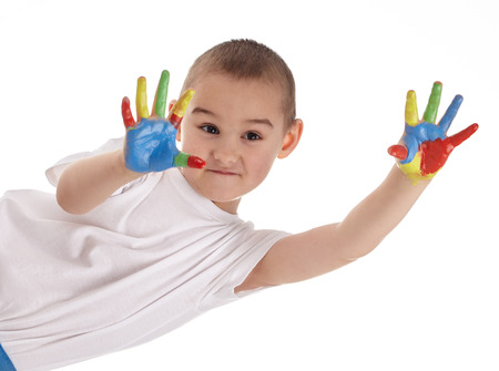 cheerful child with painted hands on white background photo