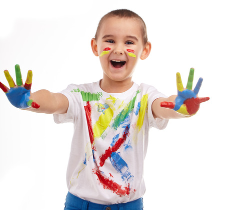 five year old: Five year old boy with hands painted in colorful paints ready for hand prints